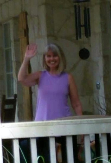 Debby Heitzke waves from her screen porch.