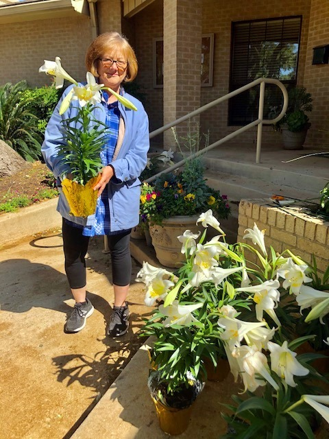 Julie McCarty helping make the lily display and distribution effort a great success.
