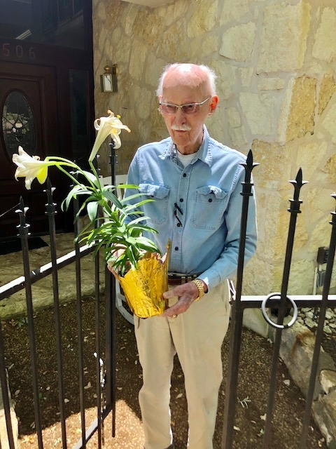 R.W. Pratt accepted a lily to enjoy with Fran.